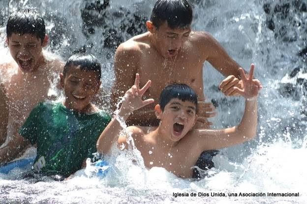 The pure joy of kids being under a waterfall