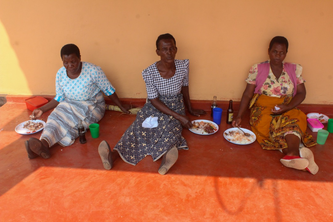 Women enjoying the meal cooked by the boys